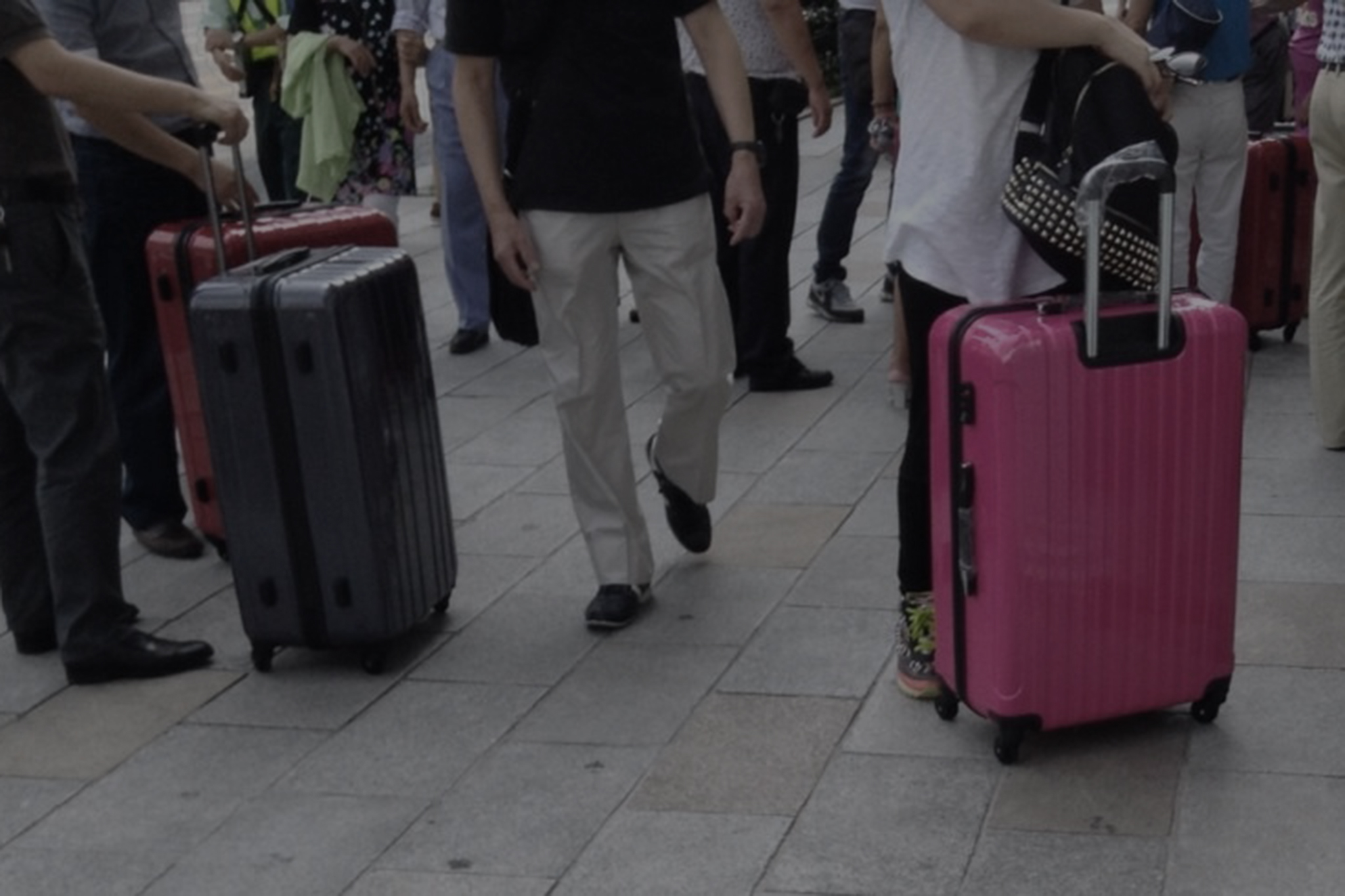 tourists with heavy luggage